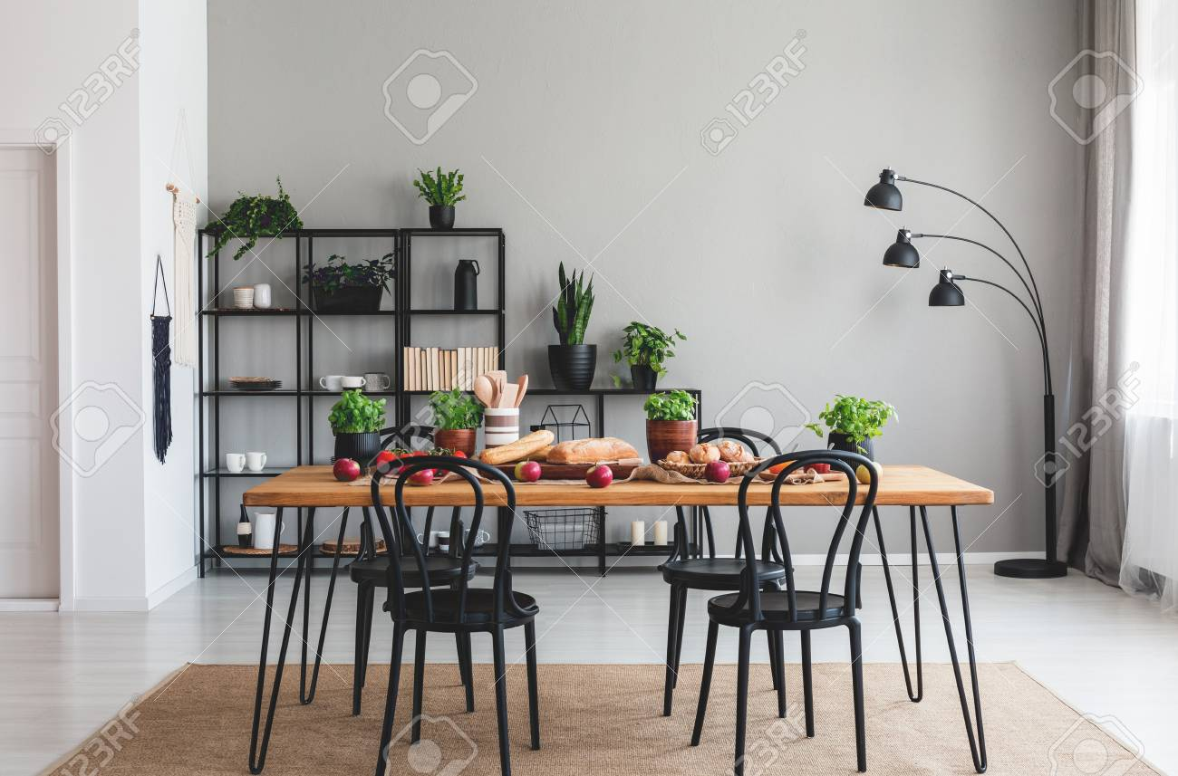 Black Chairs And Wooden Table With Food On Brown Carpet In Grey Stock Photo Picture And Royalty Free Image Image 111300382