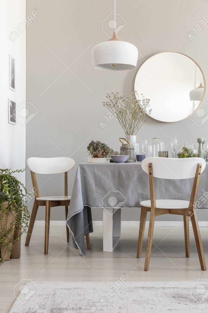 Lamp Above White Chairs And Table In Grey Dining Room Interior Stock Photo Picture And Royalty Free Image Image 111300465