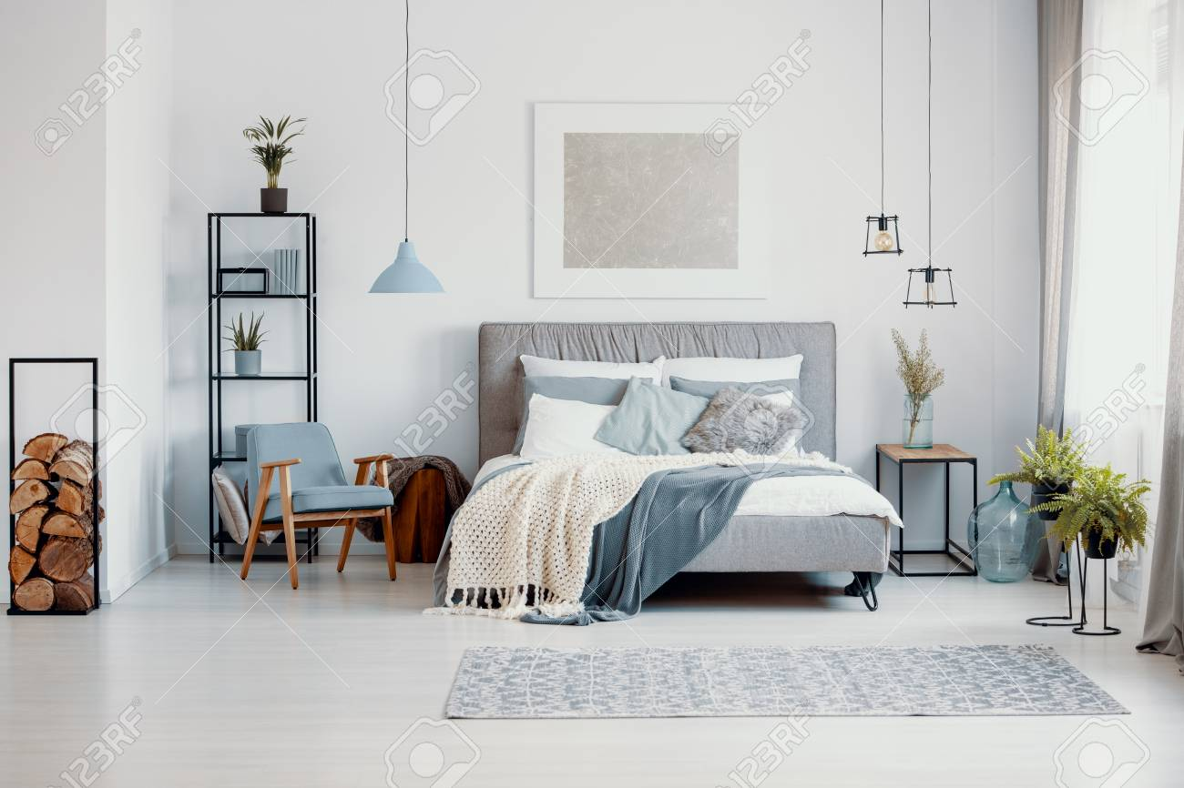 Silver Painting Above Bed With Knitted Blanket In White Bedroom Stock Photo Picture And Royalty Free Image Image 111300775
