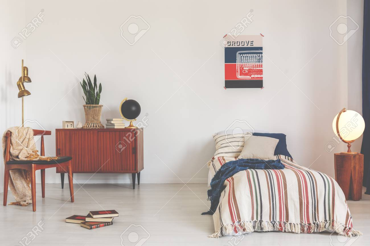 Poster Above Striped Bed In White Vintage Bedroom Interior With
