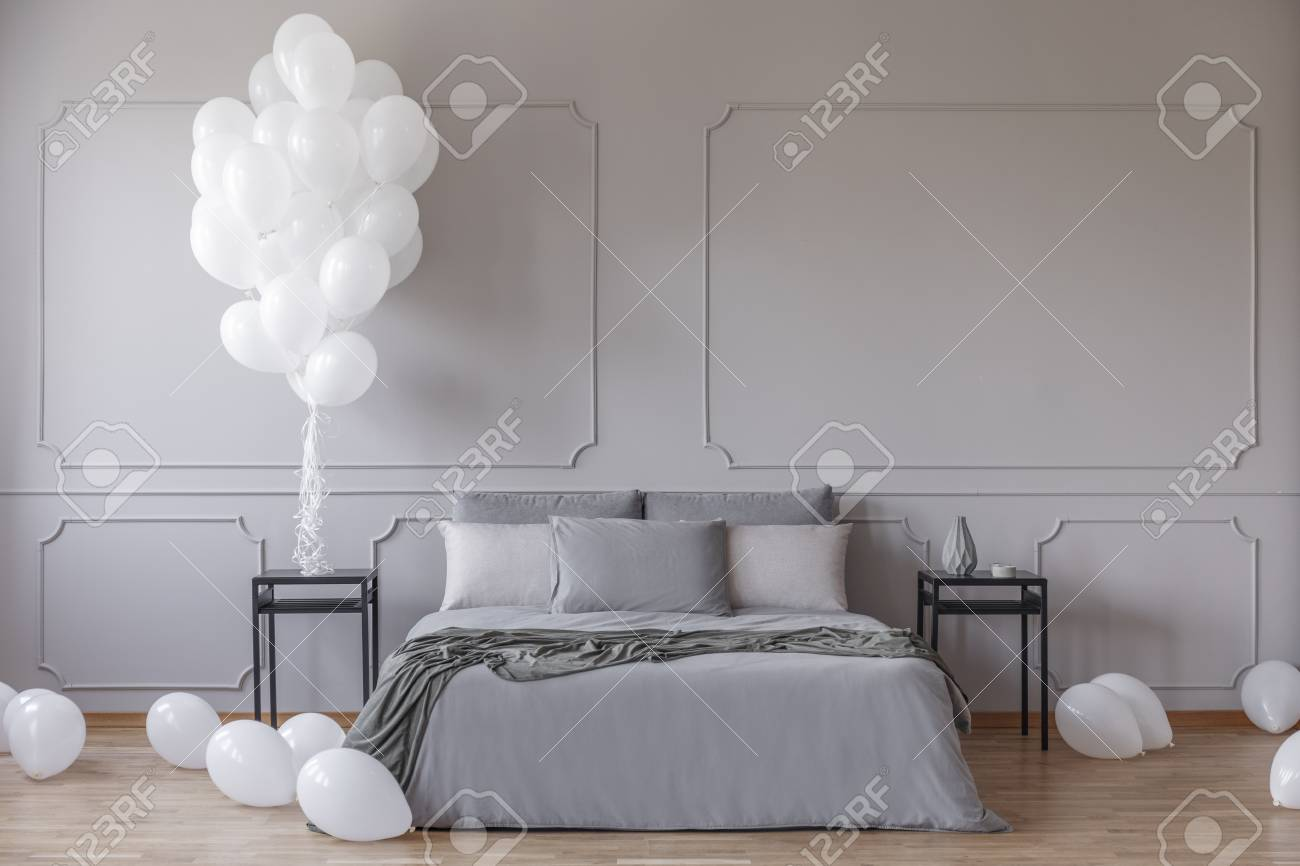 White Balloons In Spacious Bedroom With King Size Bed With Grey Stock Photo Picture And Royalty Free Image Image 111300918
