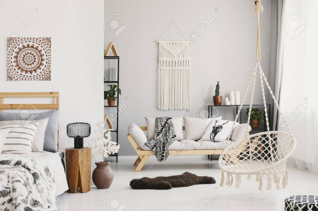Bright Living Room Interior With Macrame On The Wall Beige Couch