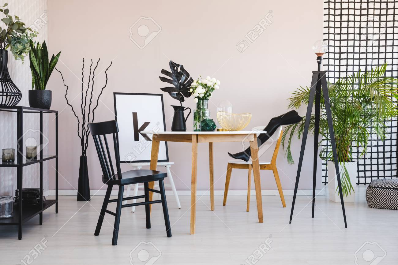 Stylish Dining Room With Round Wooden Table And Comfortable Black Stock Photo Picture And Royalty Free Image Image 112561215