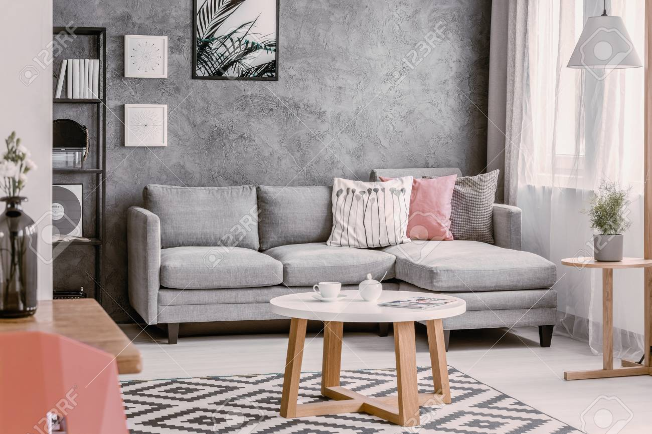Round Coffee Table On Patterned Rug In Trendsetting Living Room