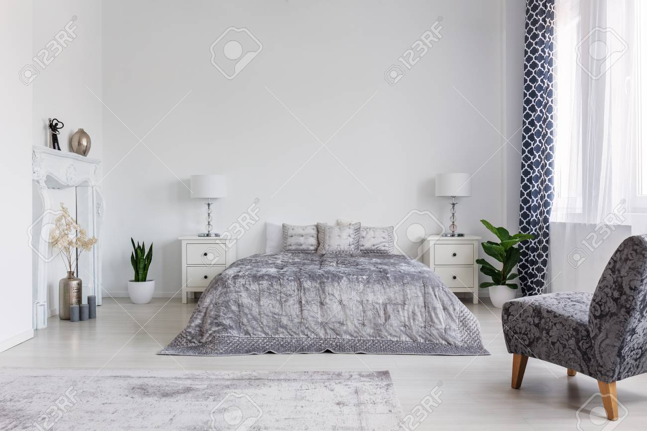 photo trendy armchair in bedroom designed in new york style real photo with copy space