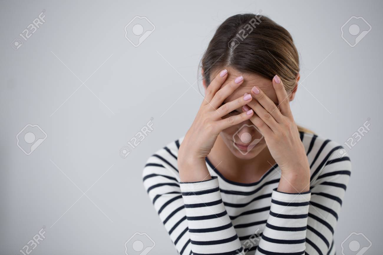 Beautiful young woman suffering from mood disorder and holding her head, photo with copy space - 114496871