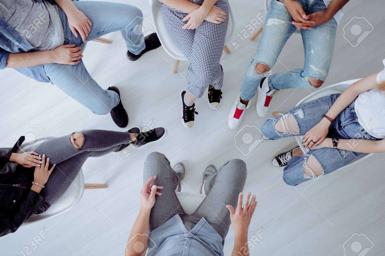 Top view of troublesome teenagers and their therapist during professional talk with counselor - 114878676