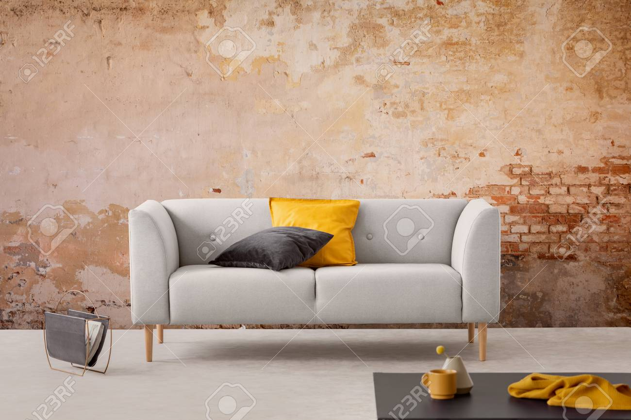 Black Table And Grey Sofa With Cushions In Simple Living Room