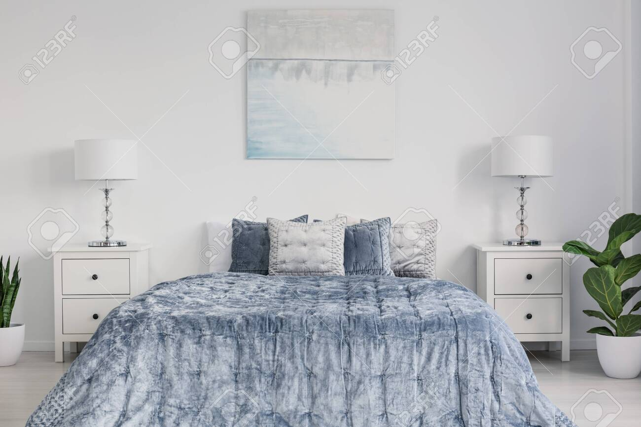 Symmetry in design of elegant new york style bedroom with king..