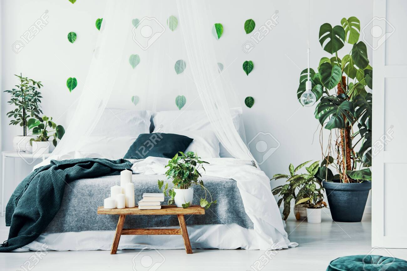 Double Bed With White And Emerald Green Bedding Grey Blanket Stock Photo Picture And Royalty Free Image Image 115888308