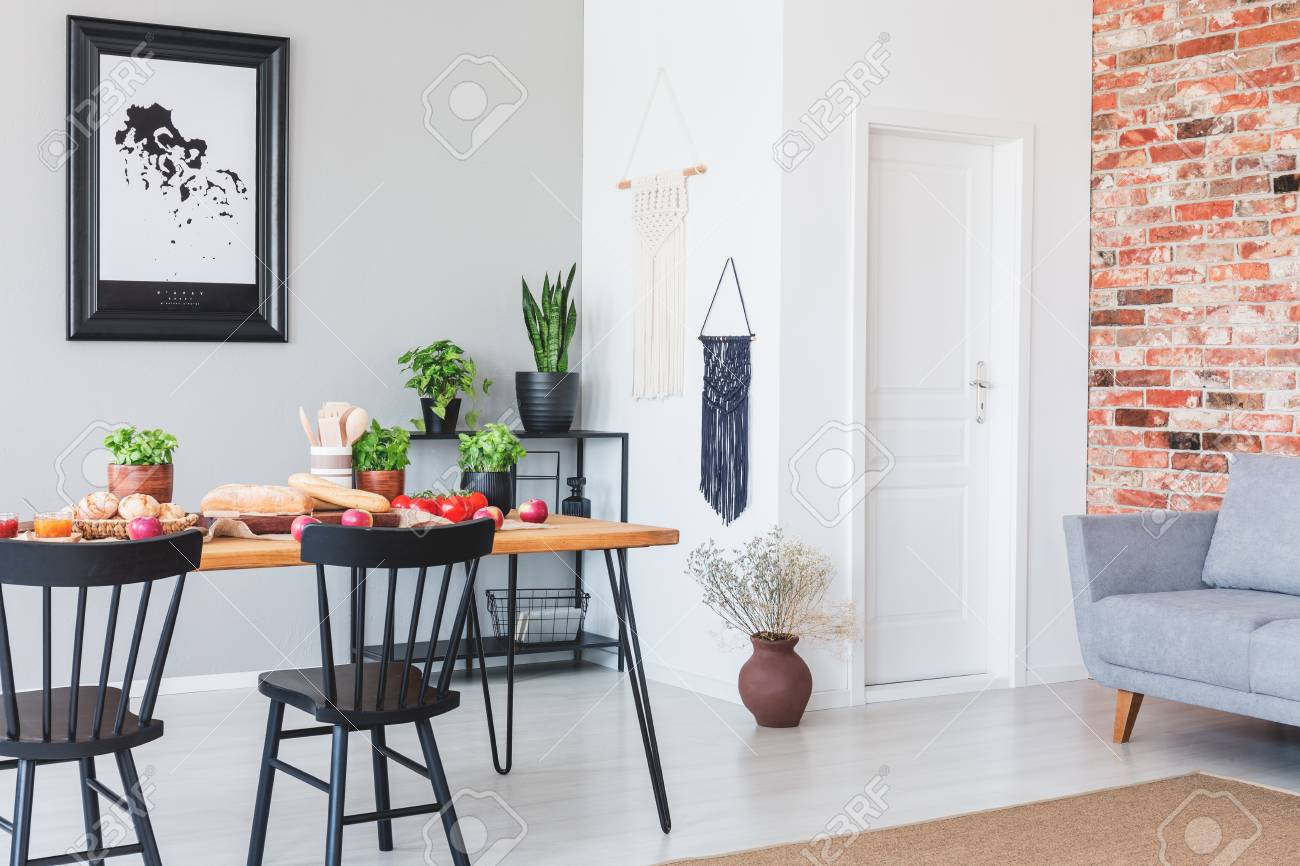 Real photo of an industrial dining room interior with a table,..