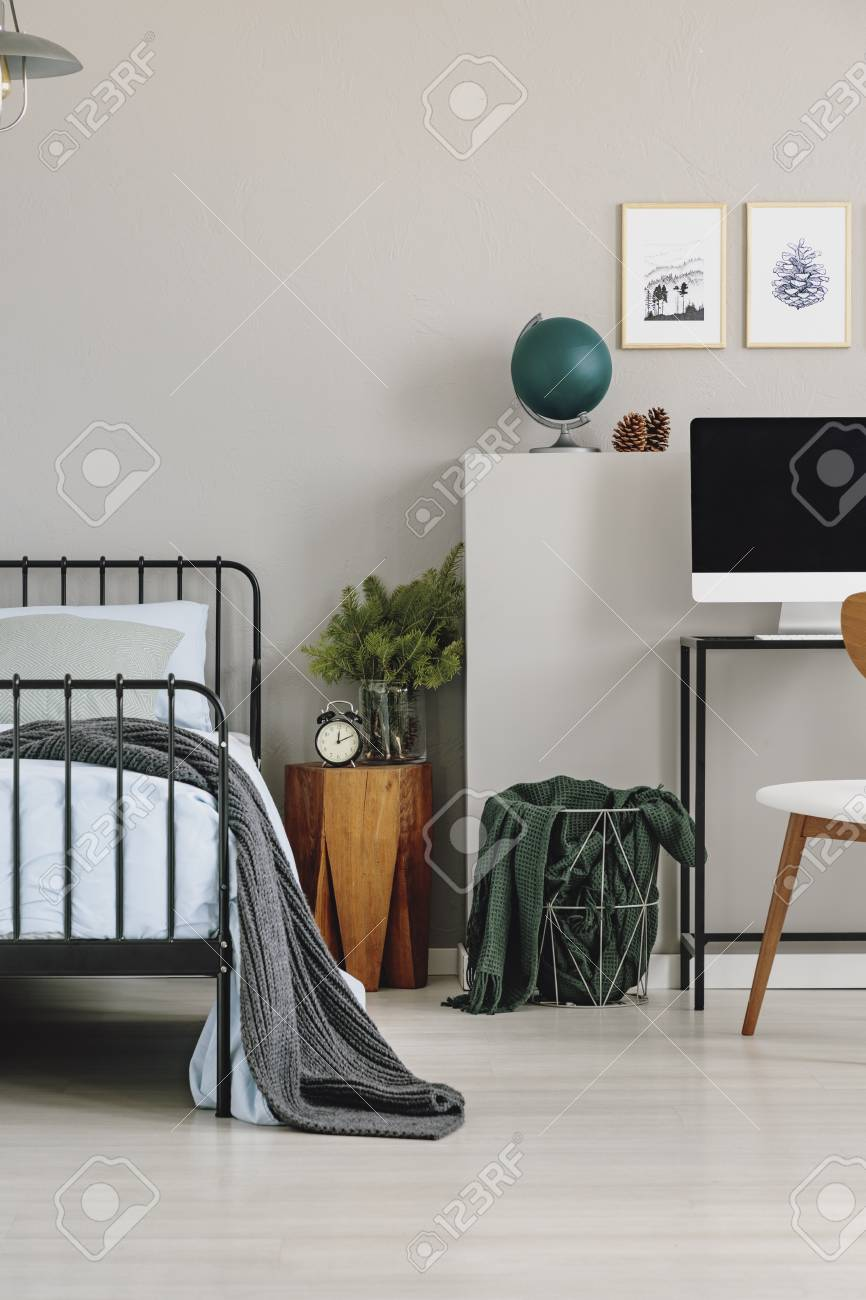 Wooden Nightstand With Spruce In Glass Vase And Clock In Grey
