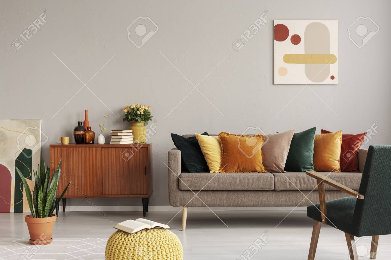 Abstract painting on grey wall of retro living room interior..