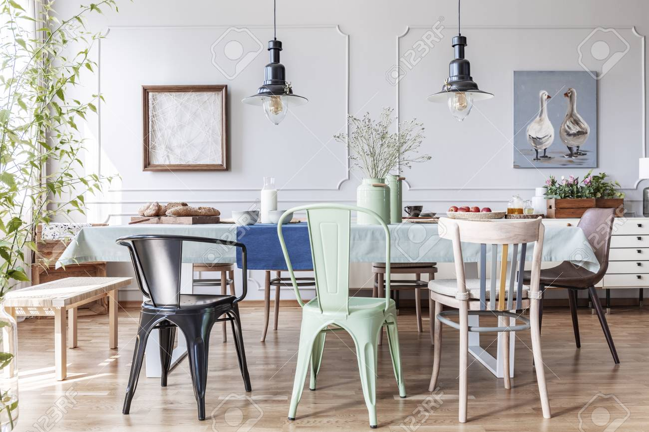 Colorful Chairs At Wooden Table Covered With Light Blue Tablecloth Stock Photo Picture And Royalty Free Image Image 119191331