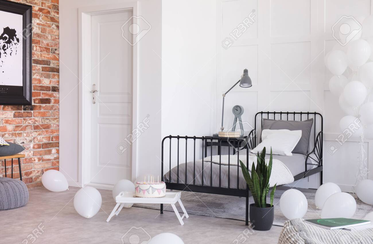 Birthday Celebration In Trendy Industrial Bedroom With Brick Stock Photo Picture And Royalty Free Image Image 121162008
