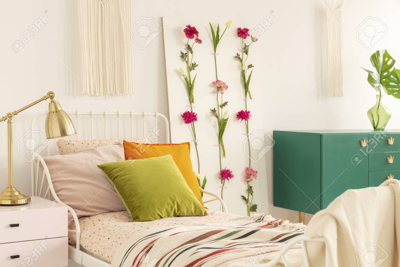Golden Lamp On Pastel Pink Nightstand Next To Single Metal Bed Stock Photo Picture And Royalty Free Image Image 121457933