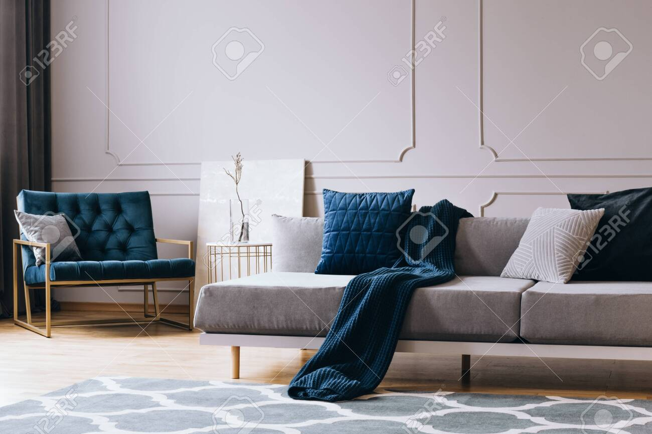 Grey Monochrome Living Room Interior With Blue Accents Stock Photo