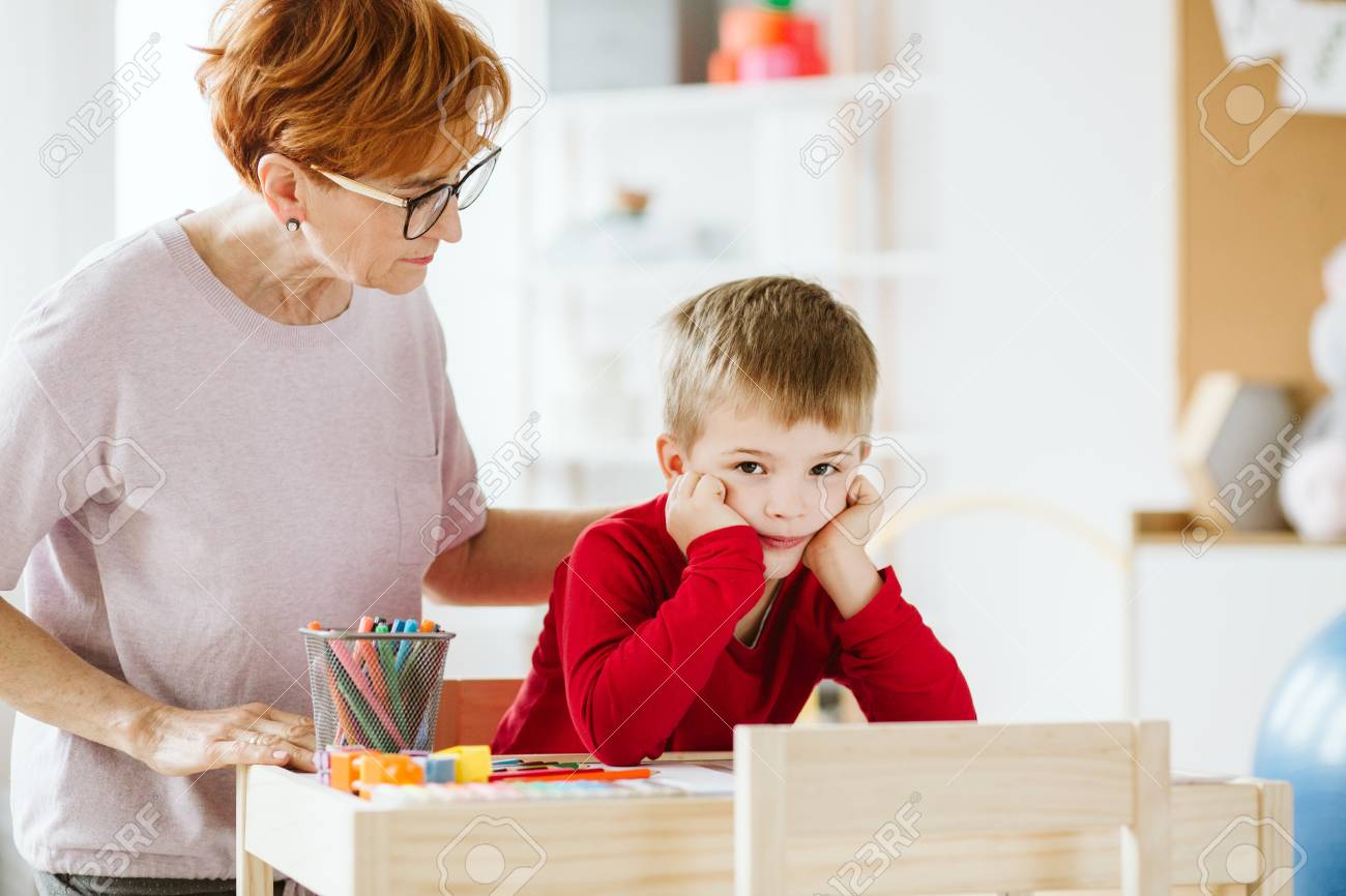 Cute little boy with problems during meeting with therapist - 123454123