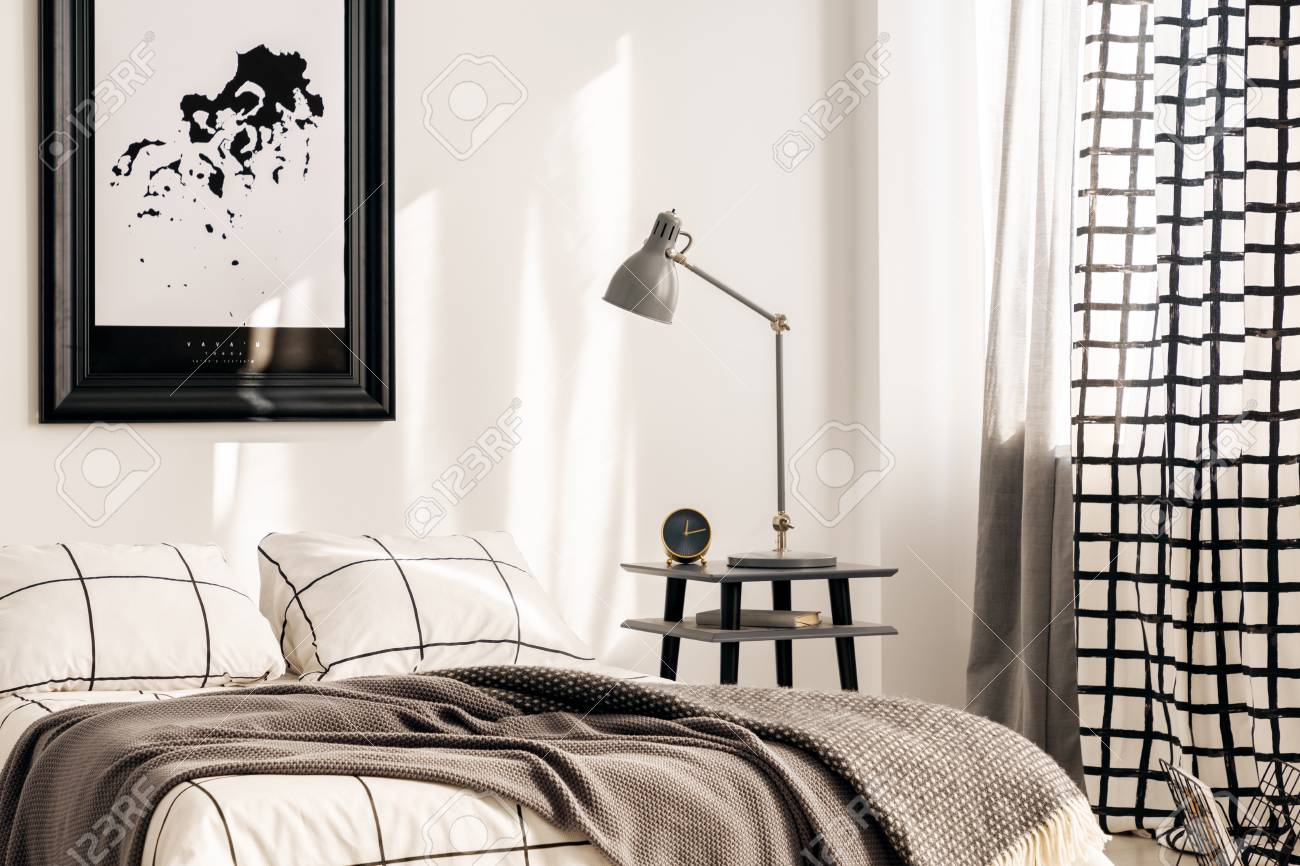 Industrial Lamp On Nightstand Table Next To King Size Bed In