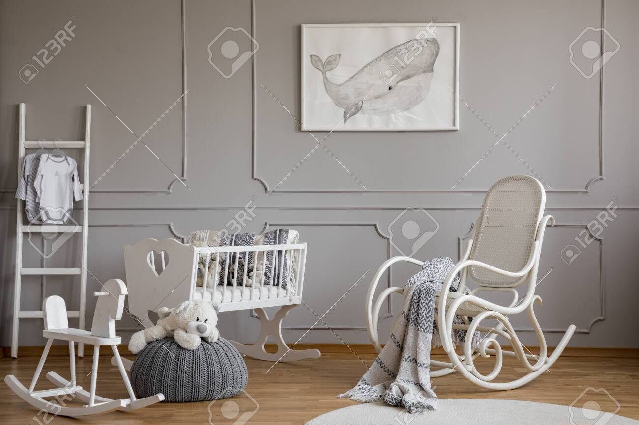Grey whale on poster in classy baby room interior with white..