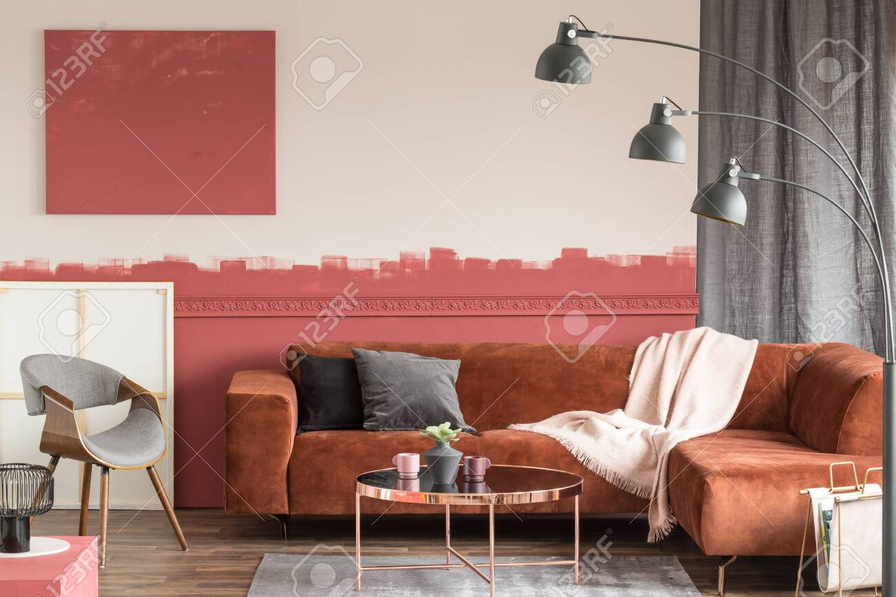 Velvet Grey And Black Pillows On Comfortable Brown Couch In Elegant