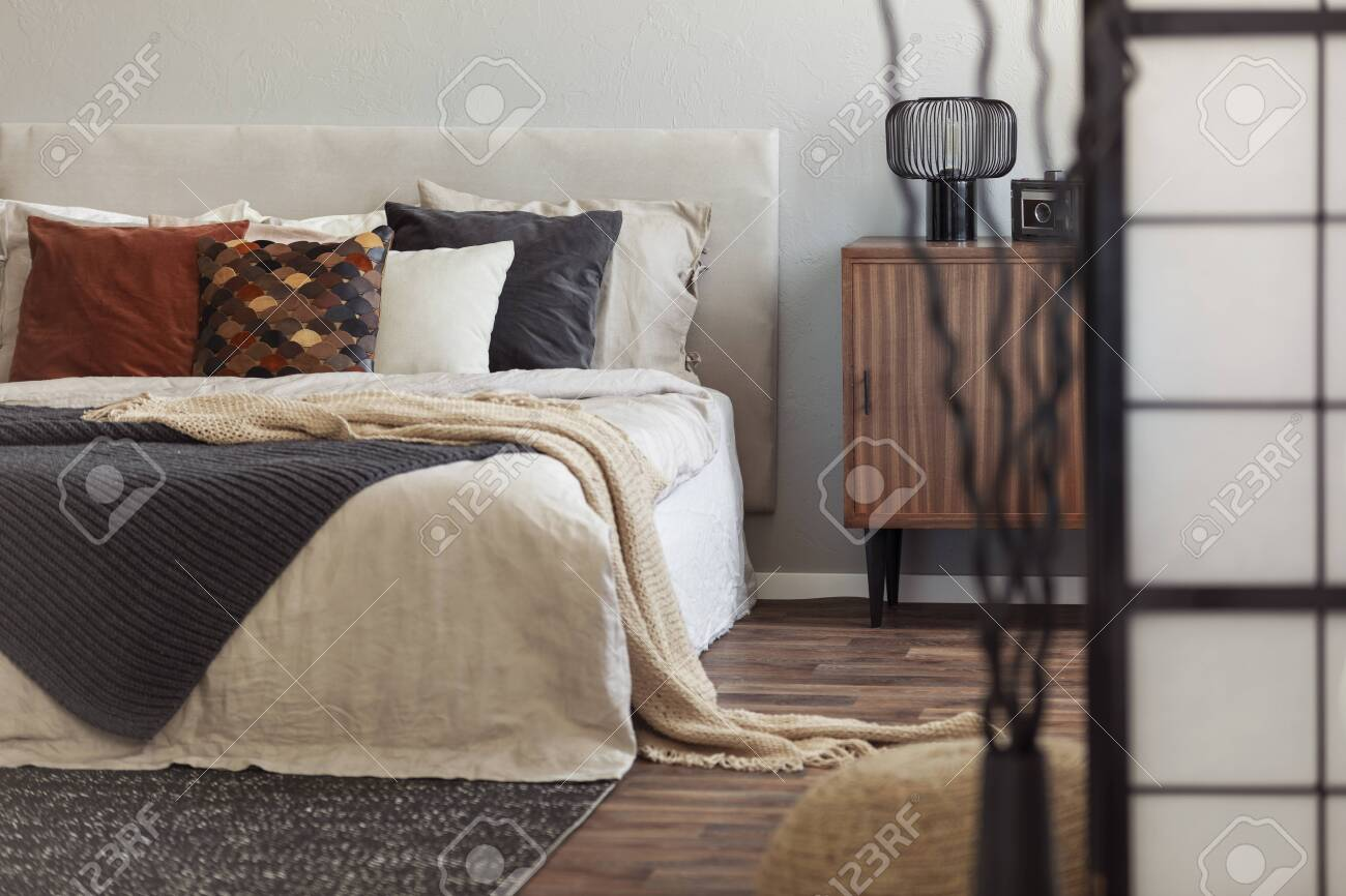 Vintage Wooden Cupboard Next To King Size Bed With Pillows And Stock Photo Picture And Royalty Free Image Image 126565183