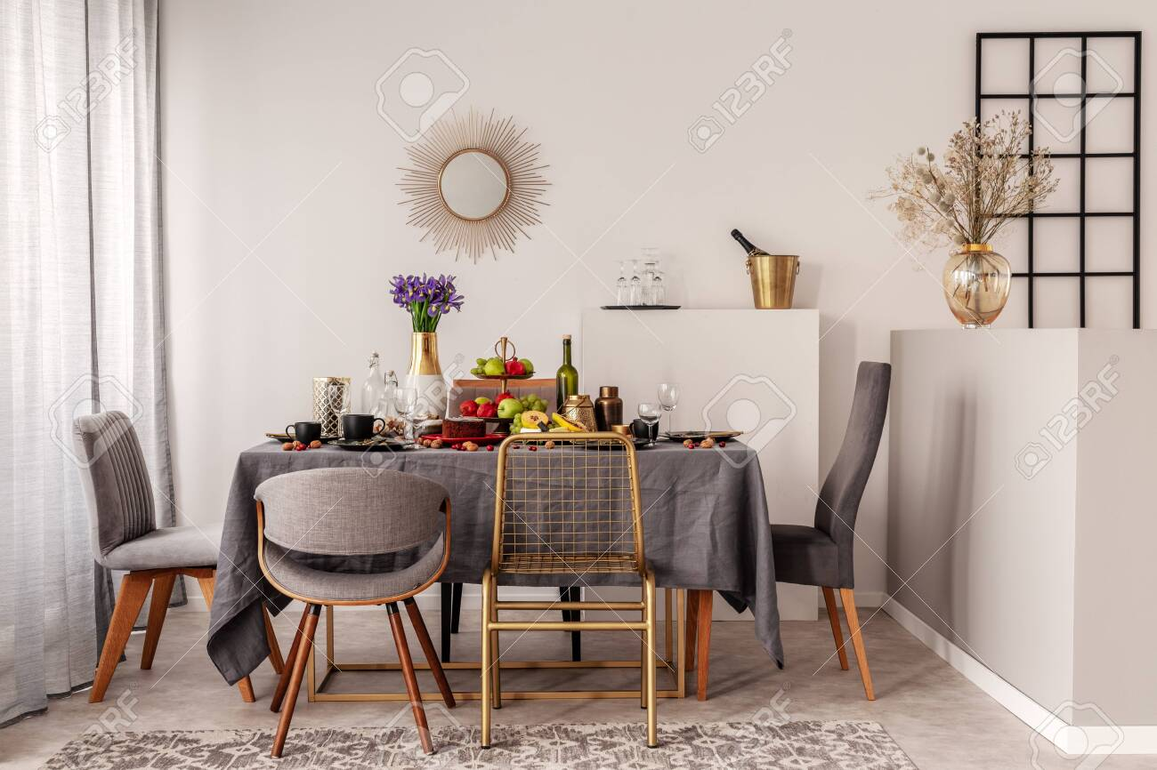 Trendy Mirror In Golden Frame On White Wall Of Elegant Dining Stock Photo Picture And Royalty Free Image Image 127522031