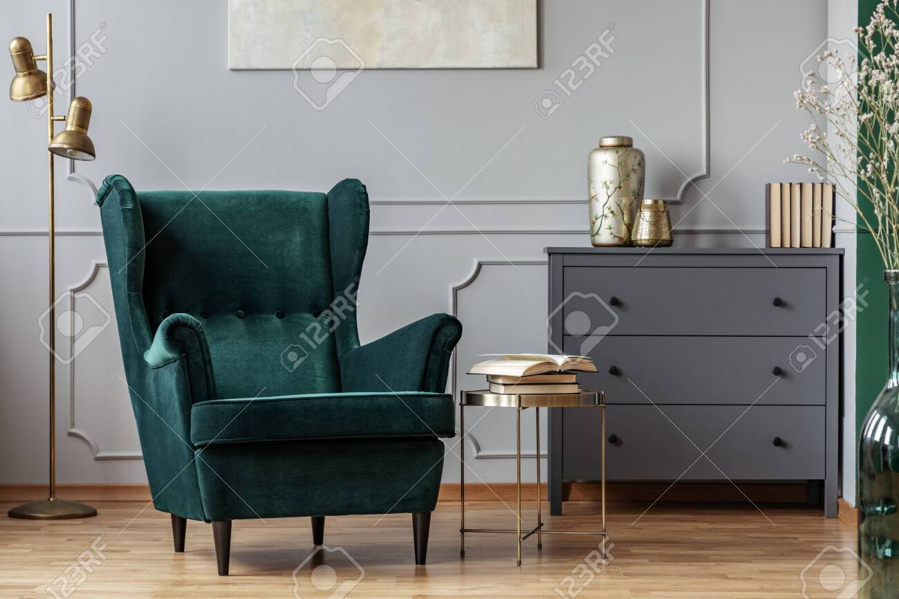 Books On Stylish Golden Small Table Next To Emerald Green Velvet Stock Photo Picture And Royalty Free Image Image 128074612