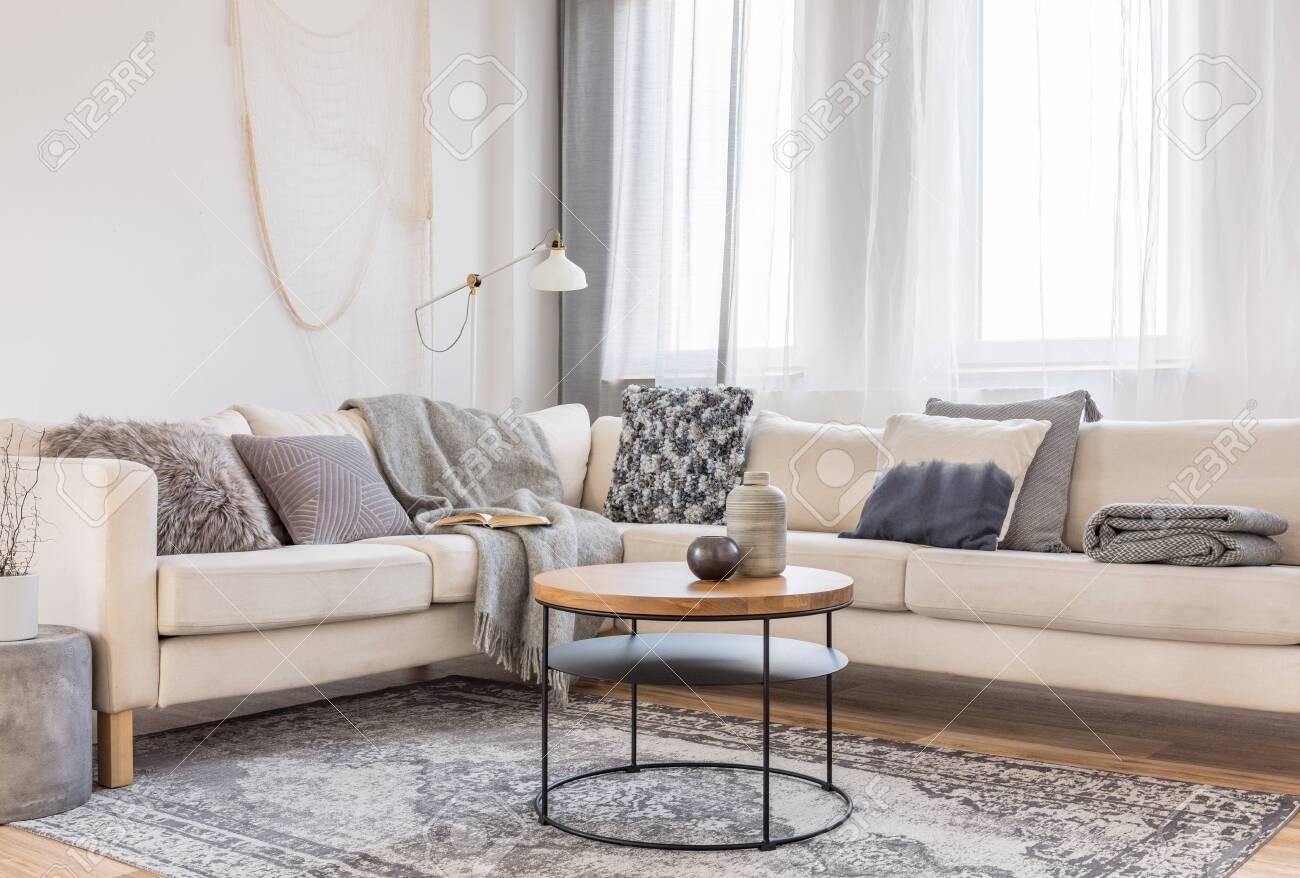 Beige Comfortable Corner Sofa With Grey Pillows In Elegant Living
