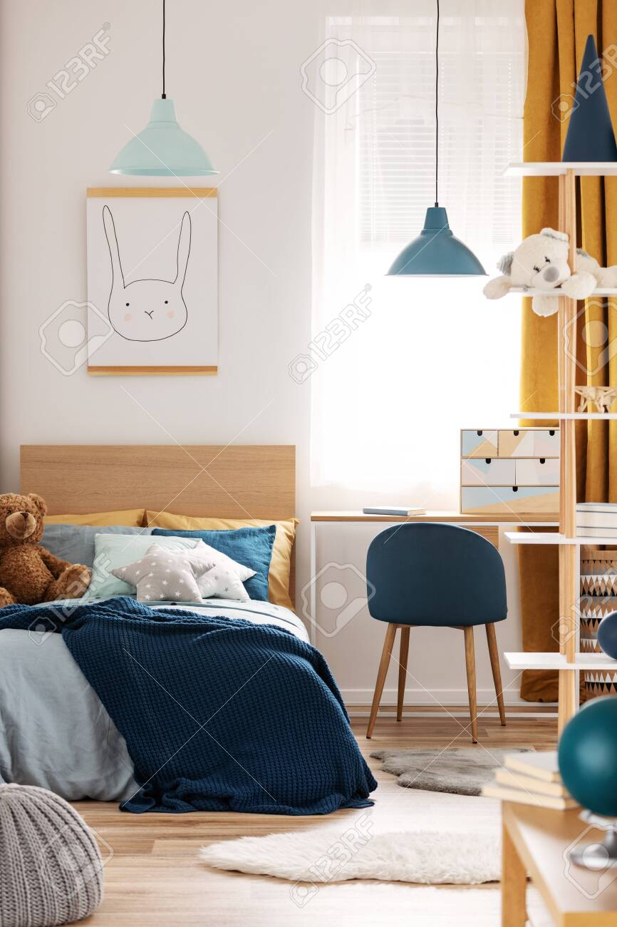 Teddy Bear On Single Wooden Bed In Blue And Orange Bedroom Interior Stock Photo Picture And Royalty Free Image Image 129348105