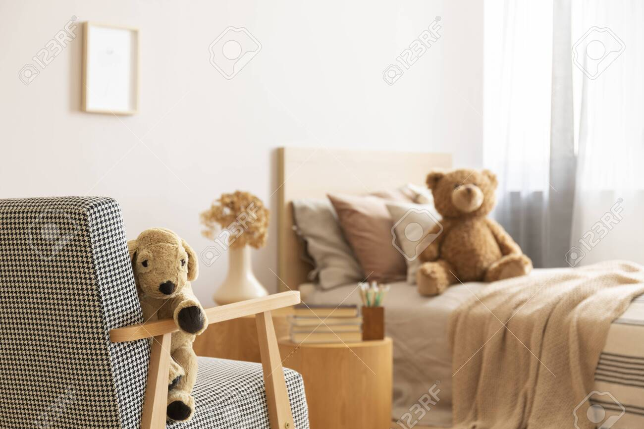 Teddy Bear On Single Wooden Bed In Natural Kid S Bedroom Stock Photo Picture And Royalty Free Image Image 129348500