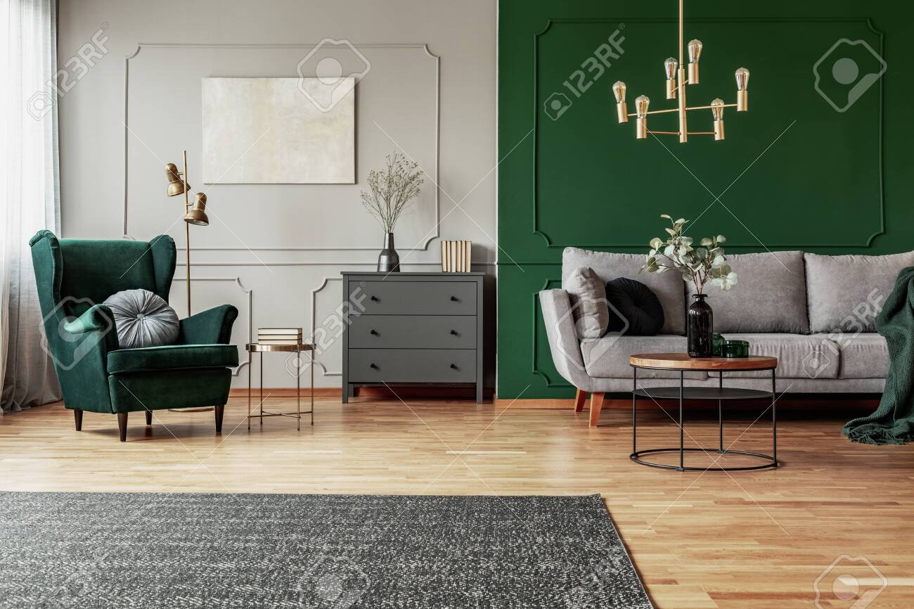 Emerald Green Wing Back Chair With Pillow In Grey Living Room Stock Photo Picture And Royalty Free Image Image 130624937