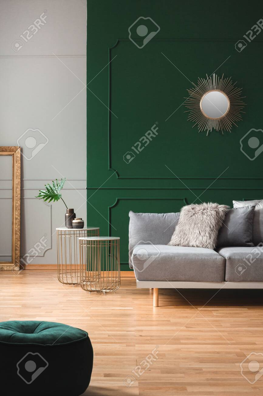 Emerald Green Living Room Interior With Grey And Golden Accents Stock Photo Picture And Royalty Free Image Image 130625363