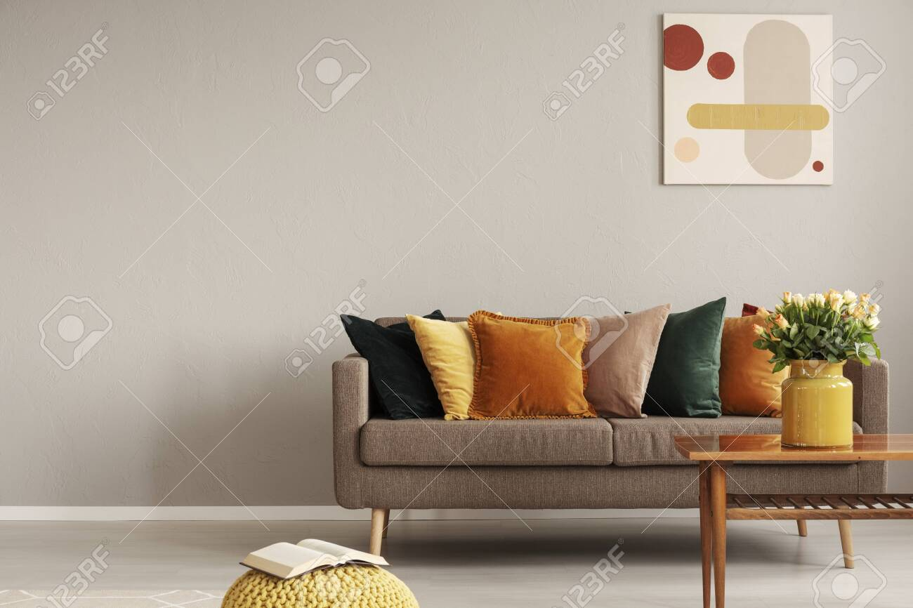 Retro style in beautiful living room interior with grey empty wall - 133531149