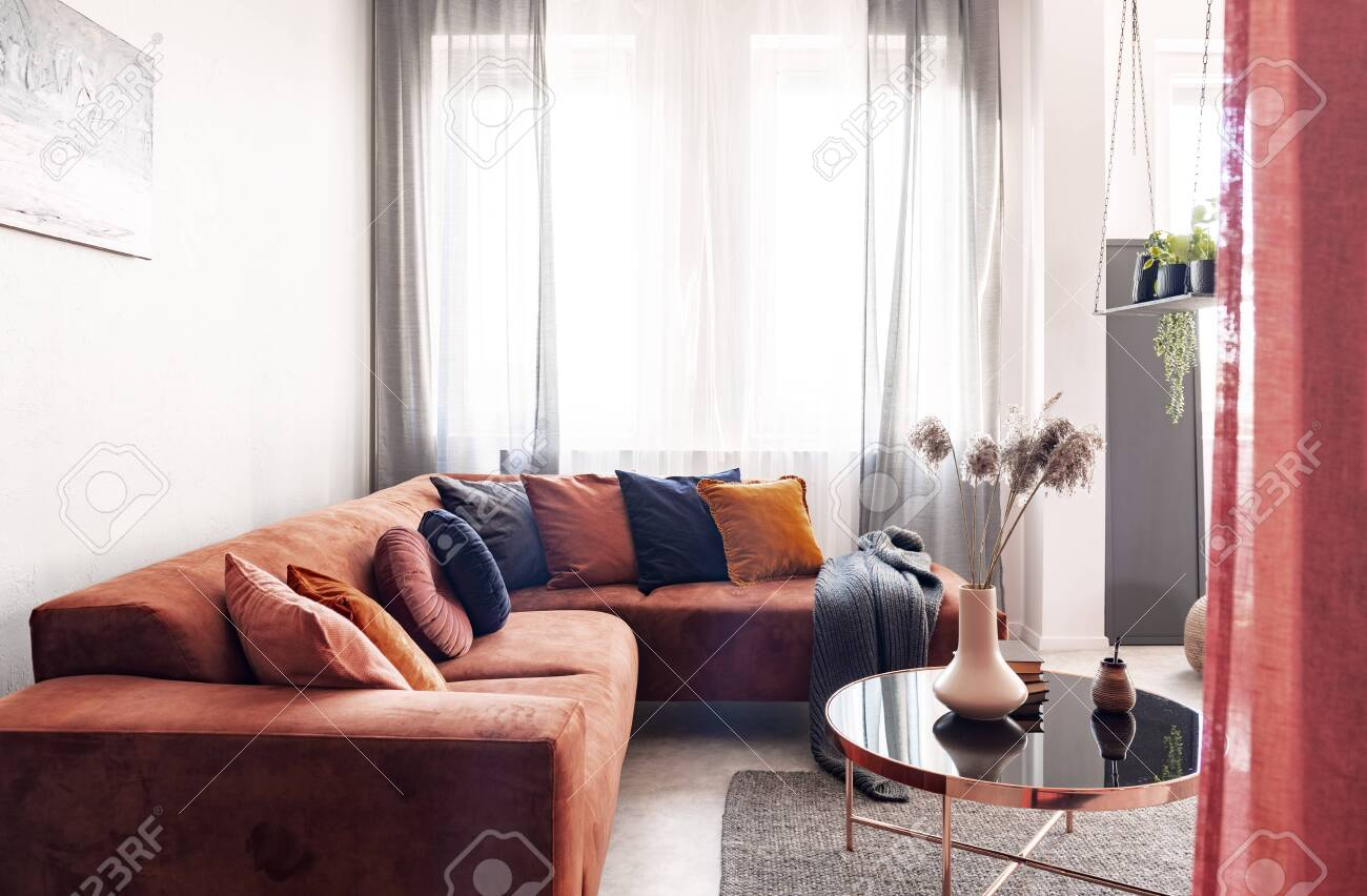 Real Photo Of Pillows On A Red Corner Sofa Standing Near The Stock Photo Picture And Royalty Free Image Image 135337354