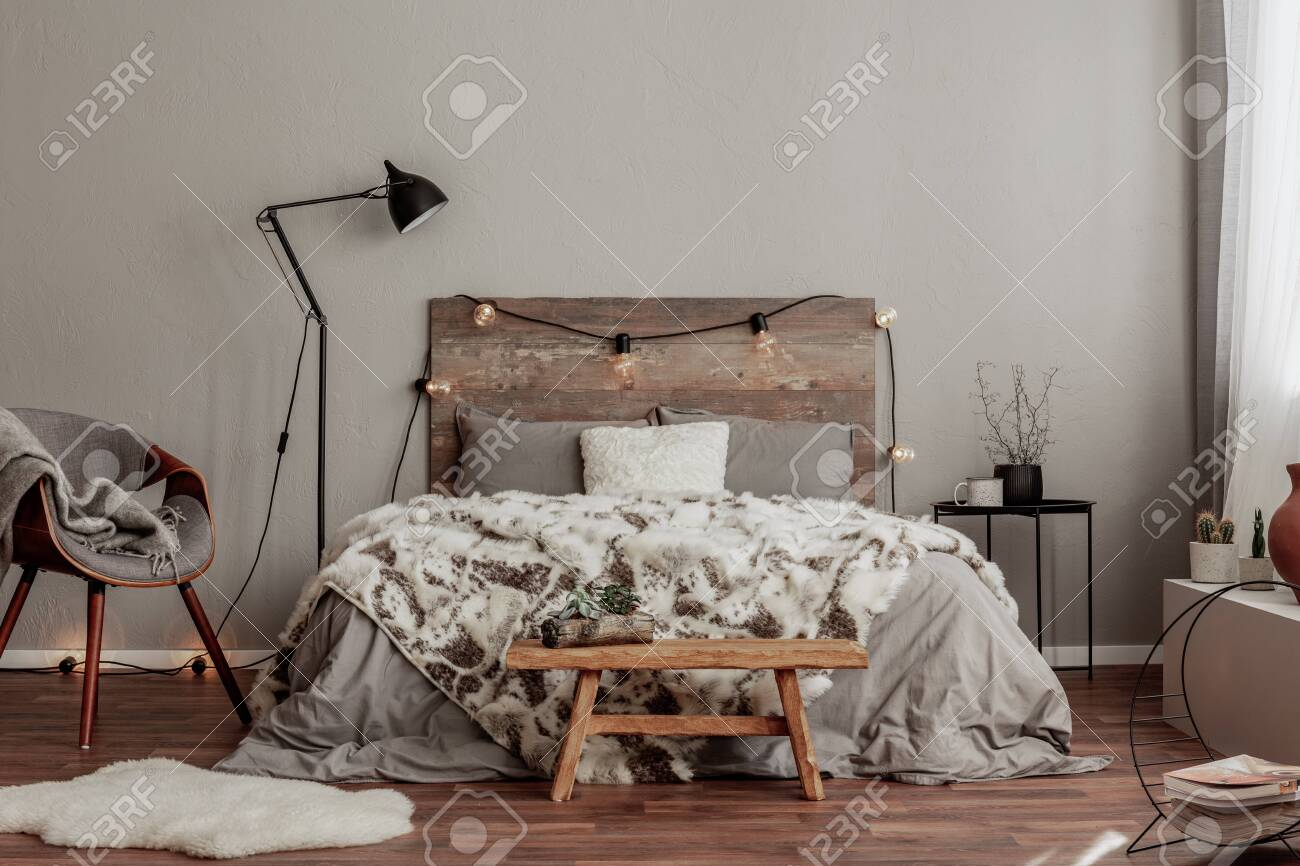 Warm Bedroom Interior With King Size Bed With Wooden Headboard Stock Photo Picture And Royalty Free Image Image 135992772