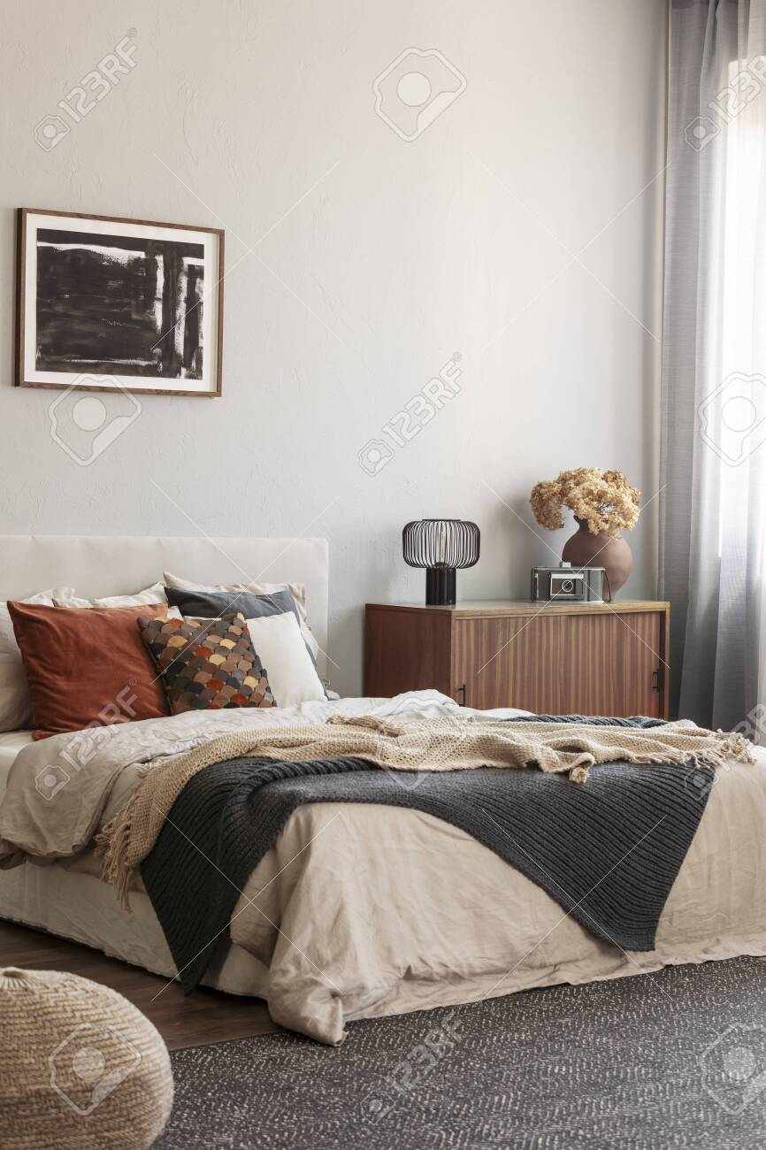 Cozy Pillows On Comfortable Big King Size Bed In Bright Bedroom
