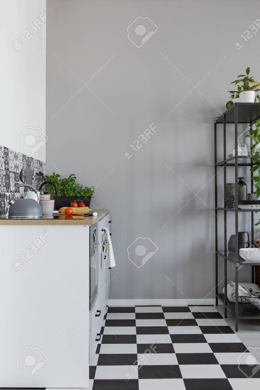 Empty Grey Wall In Small Kitchen With Black And White Floor Stock Photo Picture Royalty Free Image 140781594
