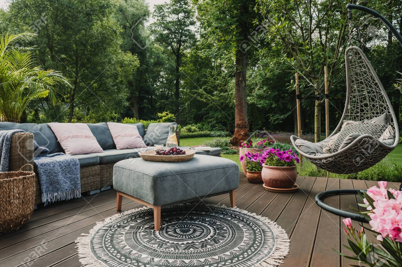- Garden Patio Decorated With Scandinavian Wicker Sofa And Coffee
