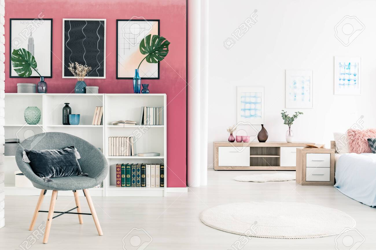 Burgundy Wall With Posters And White Bookshelf In Contemporary Stock Photo Picture And Royalty Free Image Image 153862293