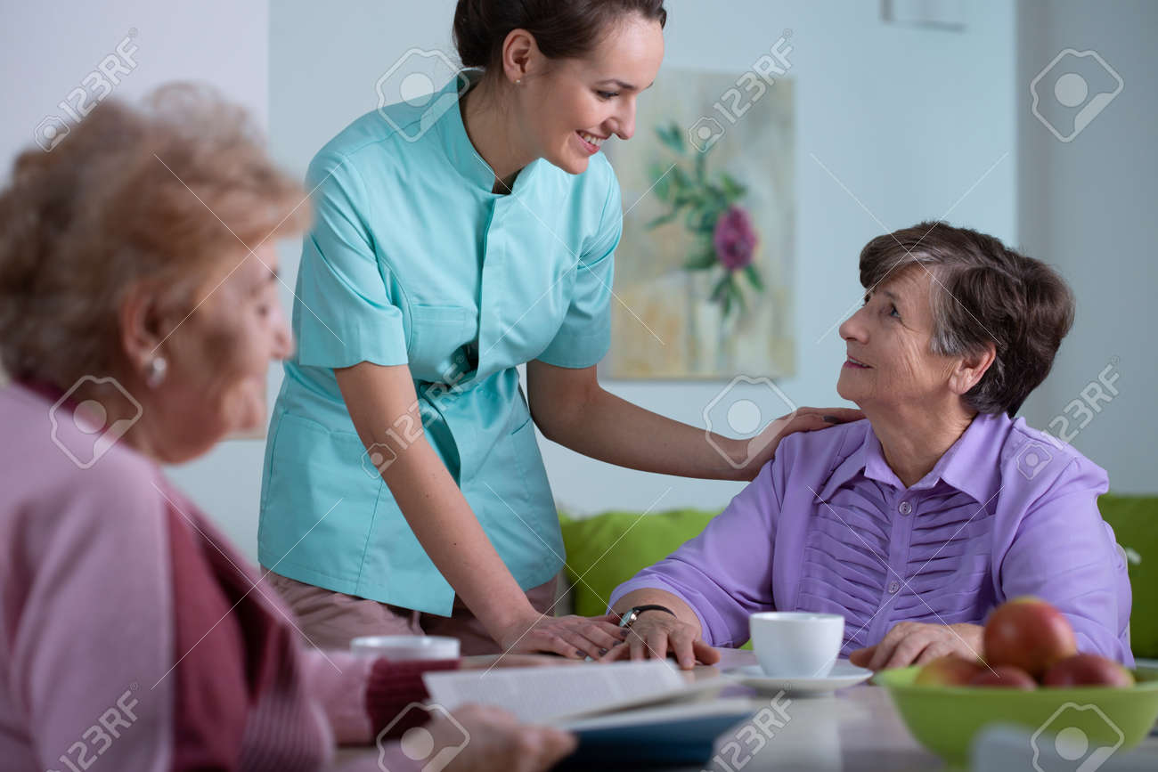 Senior patient of professional nursing home and helpful young nurse - 157067939