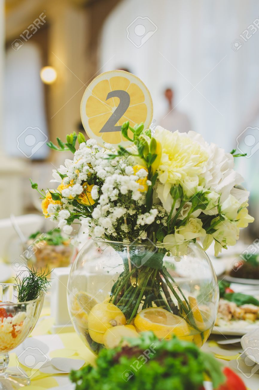 Yellow wedding table decor with statice roses and chrysanthemum stok fotoraf yellow wedding table decor with statice roses and chrysanthemum flowers table number decorated with lemon print mightylinksfo