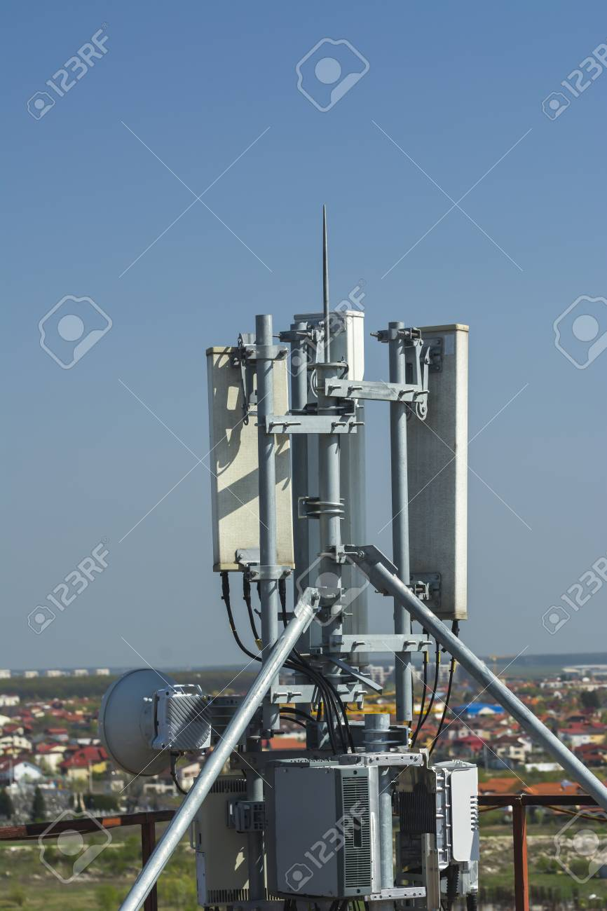 4G antenna an the roof, blue sky background, network communications,