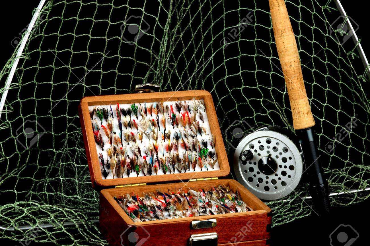 Traditional Fly Fishing Rod Reel Net And Flies In Old Wooden