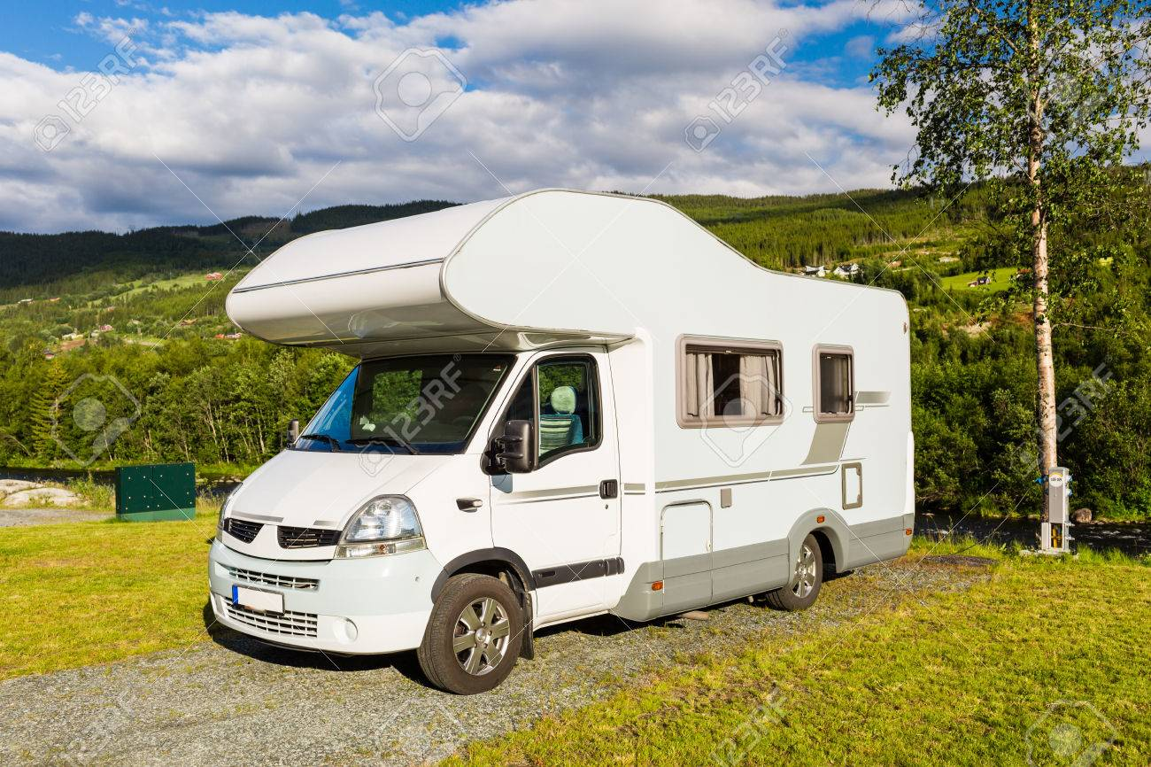 Modern White Campervan At Camping Site In Beautiful Nature In