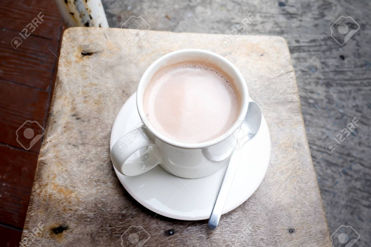 Hot Cocoa On A Wooden Chair A White Cup Of Beautiful Hot Cocoa