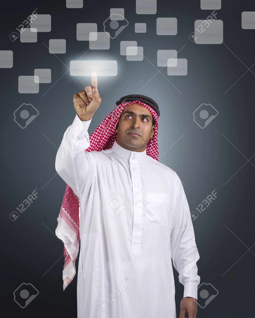 arabian businessman pressing a touchscreen button Stock Photo - 13659188