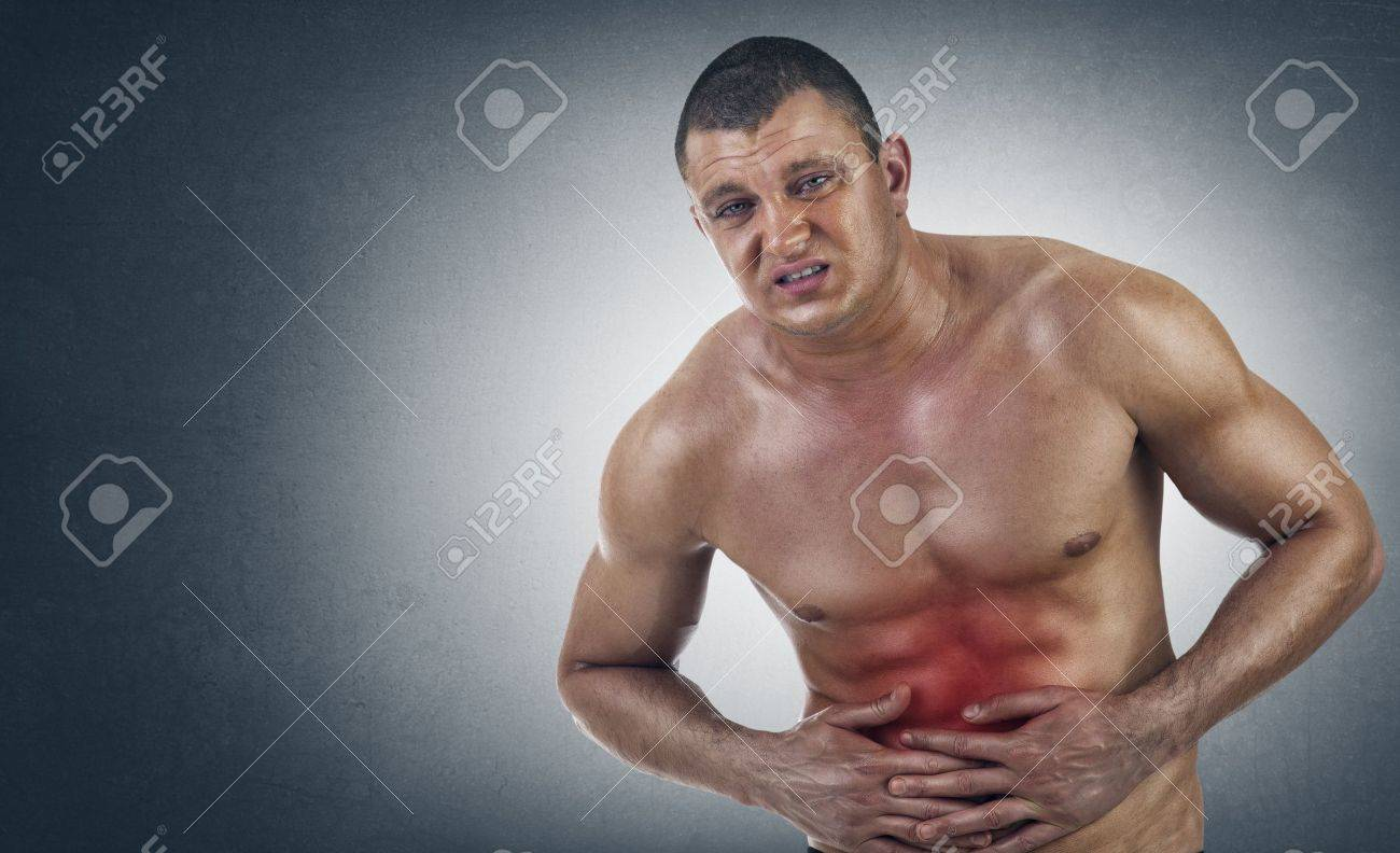 Young Athletic Man in pain Stock Photo - 13655311