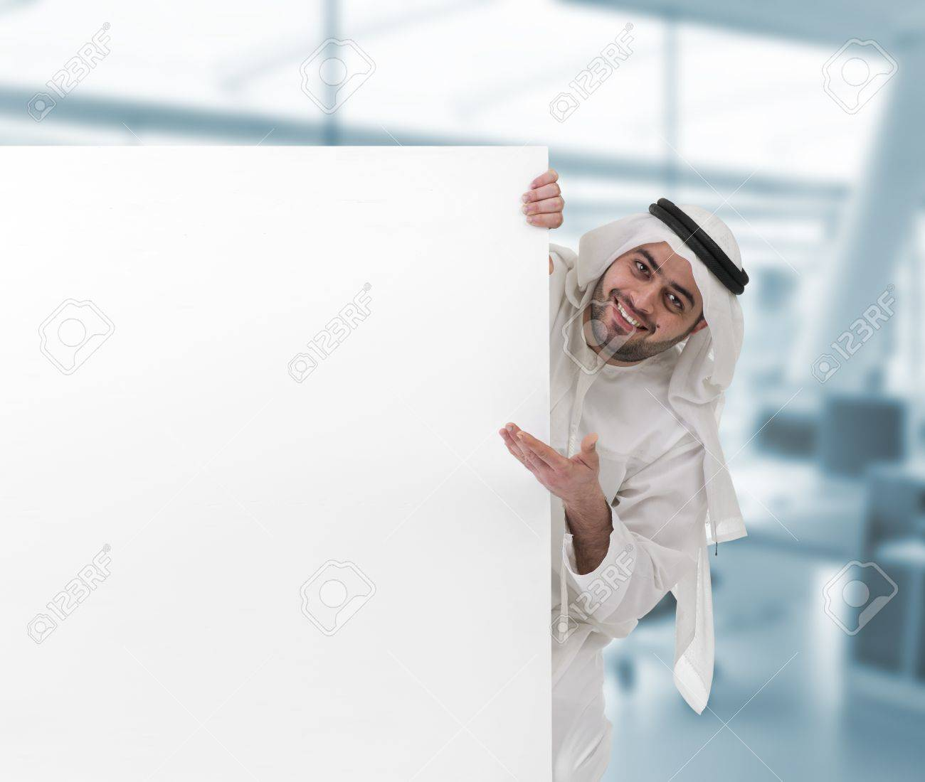 arabian business man pointing at a blank white sign Stock Photo - 13678727