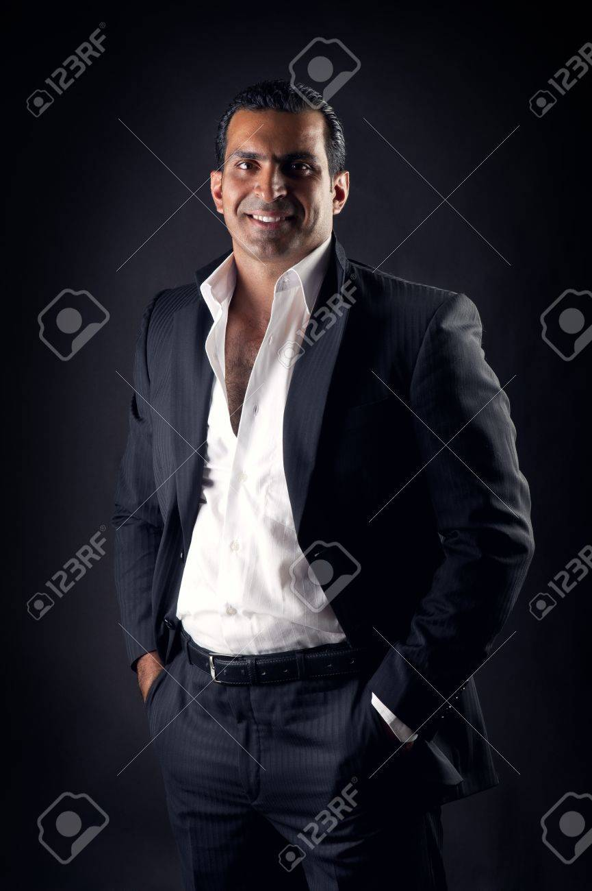 Cool businessman posing against a black background Stock Photo - 14683416